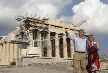 Canadian PM Harper and his wife Laureen pose for a photograph in front of the of the Parthenon temple in Athens