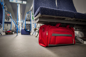 Terrorism and public safety concept with unattended bag left in a subway cart, train carriage or monorail. Travelers should report suspicious items to the police or security staff with copy space