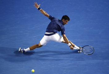 Serbia's Djokovic stretches for a shot during his quarter-final match against Japan's Nishikori at the Australian Open tennis tournament at Melbourne Park