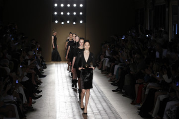 Models present creations by French designer Christophe Josse as part of his Haute Couture Fall-Winter 2012/2013 fashion show in Paris