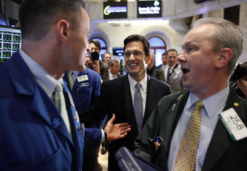 House Majority Leader Congressman Eric Cantor talks with traders on the floor of the New York Stock Exchange