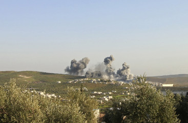 Smoke rises after what activists said was an air strike on Atimah