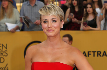 "Actress Kaley Cuoco-Sweeting of the CBS series ""The Big Bang Theory"" poses on arrival at the 21st annual Screen Actors Guild Awards in Los Angeles"