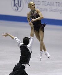 Volosozhar and Trankov of Russia perform in the pairs short program at the ISU World Team Trophy in Figure Skating in Tokyo