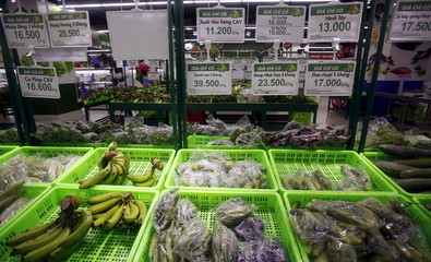 Fruits and vegetables are displayed for sale at a V+ supermarket in Hanoi, Vietnam