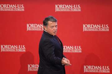 Jordan's King Abdullah arrives to deliver his speech at the opening ceremony of the Jordan-U.S. Business Forum in Amman