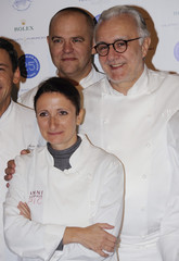French chef Ducasse poses with French chef Pic as part of celebrations of the 25th anniversary of his restaurant Le Louis XV in Monaco