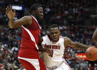 Ohio State forward Deshaun Thomas dribbles the ball around Miami University forward Julian Mavunga during the first half of the NCAA basketball game in Columbus
