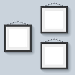 Blank photo frames hanging on the wall