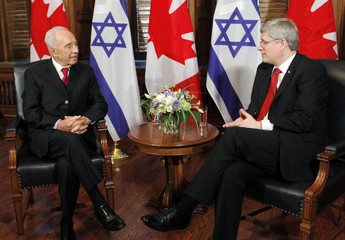 Canada's PM Harper meets with Israeli President Peres in his office following a welcoming ceremony on Parliament Hill in Ottawa