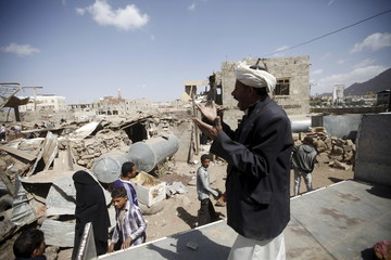 Man shouts for help to salvage his furniture after his house was destroyed by a Saudi-led air strike in Yemen's capital Sanaa