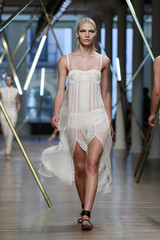 A model presents a creation from the Jason Wu Spring/Summer 2014 collection during New York Fashion Week