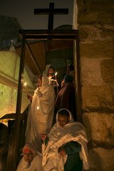 Ethiopian Orthodox worshippers hold candles during the Holy Fire ceremony  in Jerusalem's Old City