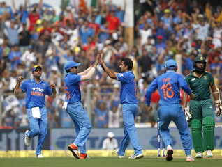 India's Sharma celebrates with his teammate Rohit after taking the wicket of South Africa's Amla during their fifth and final one-day international cricket match in Mumbai