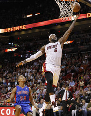 Miami Heat's James goes to basket past Detroit Pistons' English during NBA game at American Airlines Arena in Miami