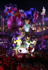 A float with giant figures of French President Hollande and French Prime Minister Valls is paraded through the crowd during the Carnival parade in Nice