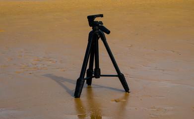 Camera Tripod on a beach