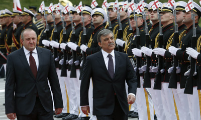 Georgia's President Margvelashvili and his Turkish counterpart Gul review honour guard during a welcoming ceremony in Tbilisi