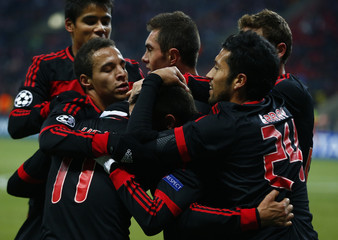 Benfica players celebrate a goal against Spartak Moscow during their Champions League Group G soccer match at Luzhniki stadium in Moscow