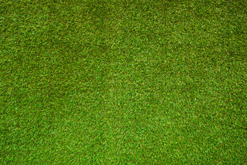 Green grass texture, grass background. Top view of artificial green grass for golf course and soccer field.