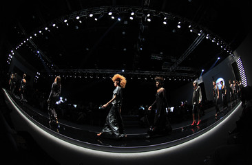Models present creations by Paris based fashion designer Xuly Bet from Mali during the Africa Fashion week in Johannesburg