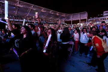 People hold their mobile phones up during a performance by the DJ duo The Chainsmokers during KIIS-FM Wango Tango concert at StubHub Center in Carson