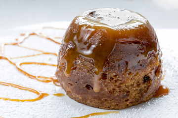 Sticky Toffee Pudding Close Up With Caramel Sauce