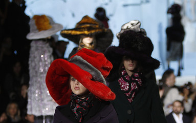 Models present creations at the Marc Jacobs Fall/Winter 2012 collection show during New York Fashion Week