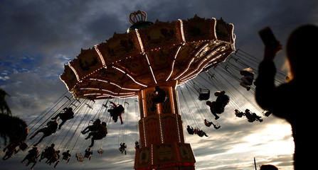 People ride on a merry-go-round carousel in Stockholm