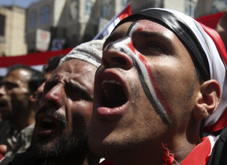Anti-government protesters shout slogans during a protest demanding the ouster of Yemen's President Ali Abdullah Saleh outside Sanaa University