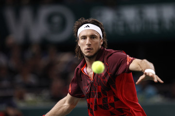 Argentina's Juan Monaco returns the ball to Switzerland's Roger Federer during their quarter-final match in Paris Masters tennis tournament