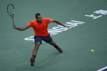 Jo-Wilfried Tsonga of France returns a shot to Novak Djokovic of Serbia during their men's singles final match at the Shanghai Masters tennis tournament in Shanghai