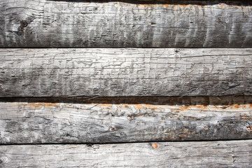 Wooden wall from logs as a background texture