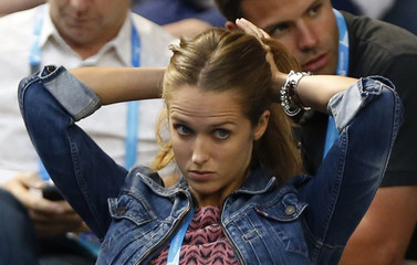 Kim Sears, girlfriend of Andy Murray of Britain, adjusts her hair at the Australian Open 2014 tennis tournament in Melbourne