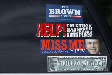 Bumper stickers against  President Obama and for Scott Brown, a Republican candidate for the U.S. Senate, are stuck to a car window outside a Brown campaign stop in Hudson