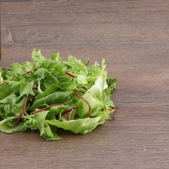 Fresh salad on the wooden table