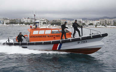French Gendarmes on boat patrol in the bay of Cannes to survey the coast and the boats few hours before the opening ceremony of the 69th Cannes Film Festival in Cannes, France