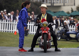 Bossier is seen on his bike as he receives second place for his 1938 Peugeot 515 motorcycle during the Concours d'Elegance in Pebble Beach