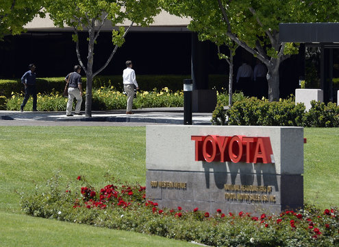 People walk at the national headquarters of Toyota Motor Sales USA, in Torrance