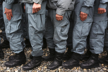 Afghan police officers stand in line to receive their lunch after a graduation ceremony at the Kabul police education centre