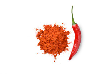 red chili pepper and chili powder on white background