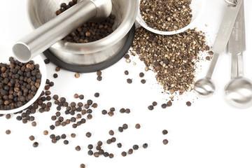 Kitchen utensils for crushing black pepper.