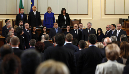 Bulgaria's newly-elected Prime Minister Borisov and his ministers take an oath after a session of the parliament in Sofia