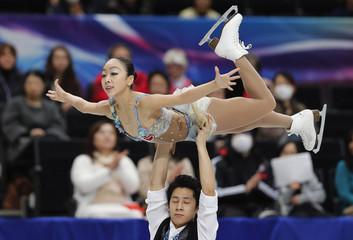 China's Sui Wenjing and Han Cong compete during the pairs short program at the ISU World Figure Skating Championships in Saitama, Japan