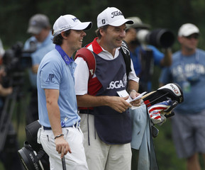McIlroy laughs with his caddie  on the eighth hle during the final round of the 2011 U.S. Open in Maryland