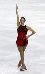 Nagasu of U.S. gestures after performing in women's free skating figure skating event at Vancouver 2010 Winter Olympics