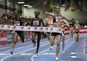 Lakhouad of Morocco reacts as she crosses finish line during women's one mile at the New Balance Indoor Grand Prix track meet in Boston