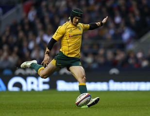 Australia's Barnes kicks a penalty during their international Rugby Union match against England at Twickenham stadium in London