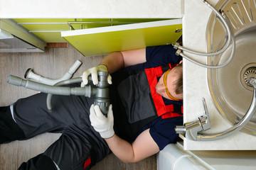 Plumber for kitchen sets sewer