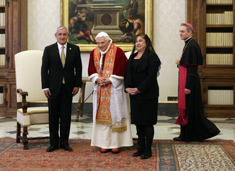 Pope Benedict XVI stands with Guatemala's President Otto Perez Molina and his wife Rosa Perez during a private audience at the Vatican